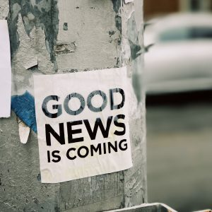 "Sign on post, says ""good news is coming"""