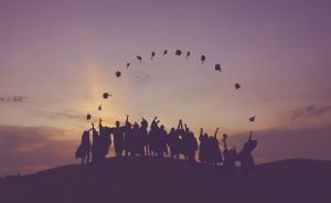 group of graduates tossing their caps
